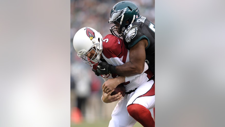 Arizona Cardinals' Carson Palmer, left, is tackled by Philadelphia Eagles' Brandon Graham during the second half of an NFL football game, Sunday, Dec. 1, 2013, in Philadelphia. (AP Photo/Michael Perez)