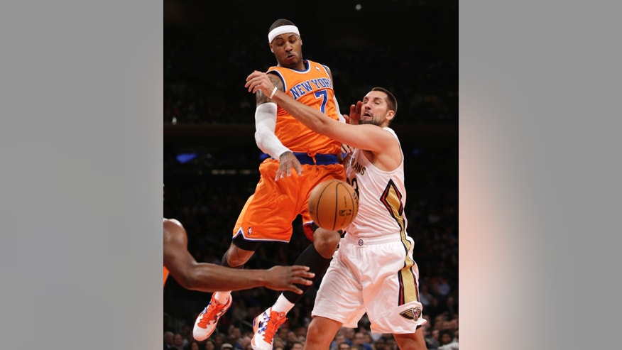 New York Knicks forward Carmelo Anthony (7) knocks the ball from the grasp of New Orleans Pelicans forward Ryan Anderson (33) in the first half of their NBA basketball game at Madison Square Garden in New York, Sunday, Dec. 1, 2013.  (AP Photo/Kathy Willens)