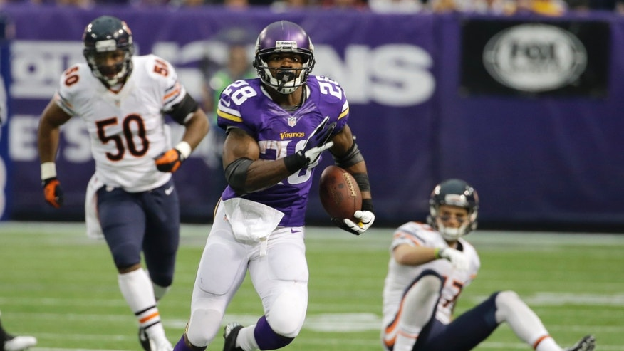 Minnesota Vikings running back Adrian Peterson, center, runs from Chicago Bears defenders James Anderson, left, and Chris Conte, right, during the first half of an NFL football game on Sunday, Dec. 1, 2013, in Minneapolis. (AP Photo/Ann Heisenfelt)