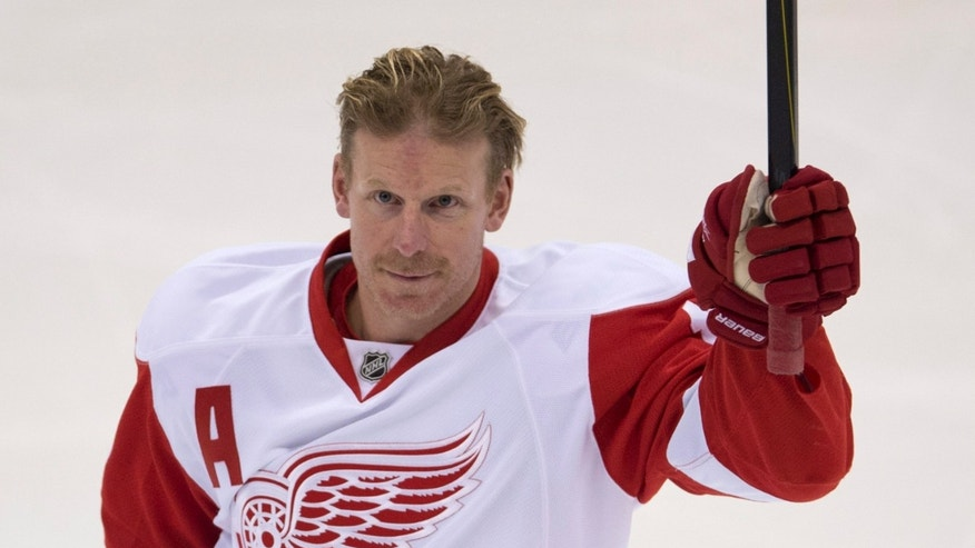 Former Ottawa Senators captain, Detroit Red Wings right wing Daniel Alfredsson acknowldges the crowd prior to the start of NHL hockey action Sunday Dec.  1, 2013 in Ottawa, Ont. The game was Alfredsson's first in Ottawa since being traded to the Red Wings. (AP Photo/The Canadian Press, Adrian Wyld)