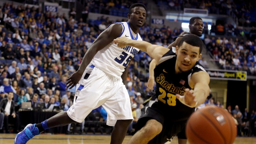 Saint Louis' Reggie Agbeko (35) watches as Wichita State's Fred VanVleet, right, reaches for a ball as it goes out of bounds during the first half of an NCAA college basketball game on Sunday, Dec. 1, 2013, in St. Louis. (AP Photo/Jeff Roberson)