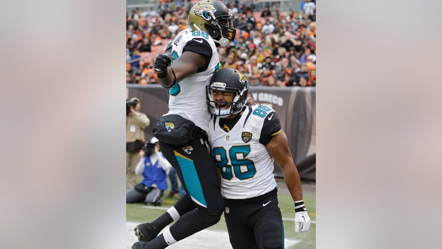Jacksonville Jaguars tight end Clay Harbor (86) celebrates his 18-yard touchdown catch with Danny Noble in the first quarter of an NFL football game against the Cleveland Browns Sunday, Dec. 1, 2013, in Cleveland. (AP Photo/Tony Dejak)