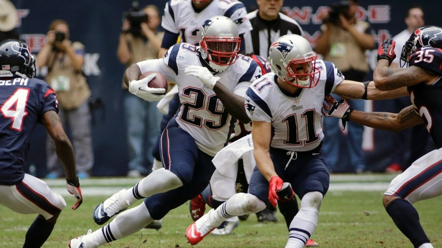 New England Patriots' LeGarrette Blount (29) runs against the Houston Texans during the second quarter of an NFL football game on Sunday, Dec. 1, 2013, in Houston. (AP Photo/David J. Phillip)