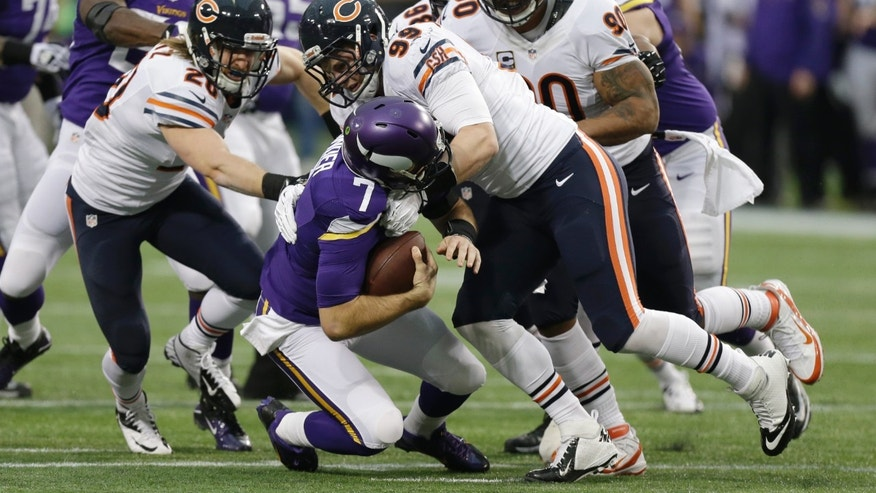 Minnesota Vikings quarterback Christian Ponder (7) is sacked by Chicago Bears defensive end Shea McClellin, right, and strong safety Craig Steltz, left, during the first half of an NFL football game, Sunday, Dec. 1, 2013, in Minneapolis. (AP Photo/Charlie Neibergall)