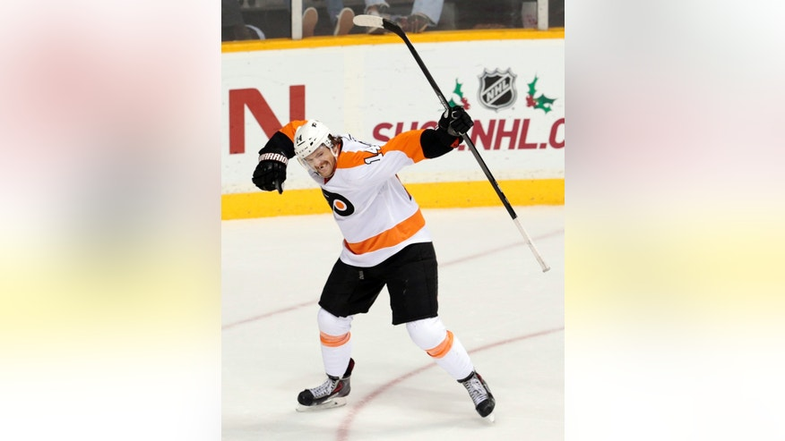 Philadelphia Flyers center Sean Couturier (14) celebrates after scoring against the Nashville Predators in the third period of an NHL hockey game Saturday, Nov. 30, 2013, in Nashville, Tenn. (AP Photo/Mark Humphrey)
