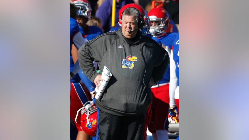 Kansas head coach Charlie Weis looks on from the sideline during the first half of an NCAA college football game against Kansas State in Lawrence, Kan., Saturday, Nov. 30, 2013. Kansas State defeated Kansas 31-10. (AP Photo/Orlin Wagner)