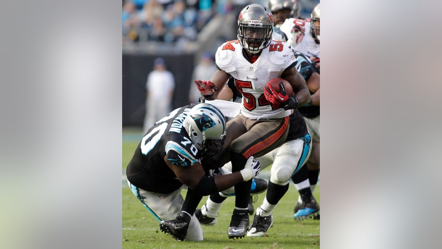 Tampa Bay Buccaneers' Lavonte David (54) is tackled by Carolina Panthers' Edmund Kugbila (70) after an interception in the second half of an NFL football game in Charlotte, N.C., Sunday, Dec. 1, 2013. (AP Photo/Bob Leverone)