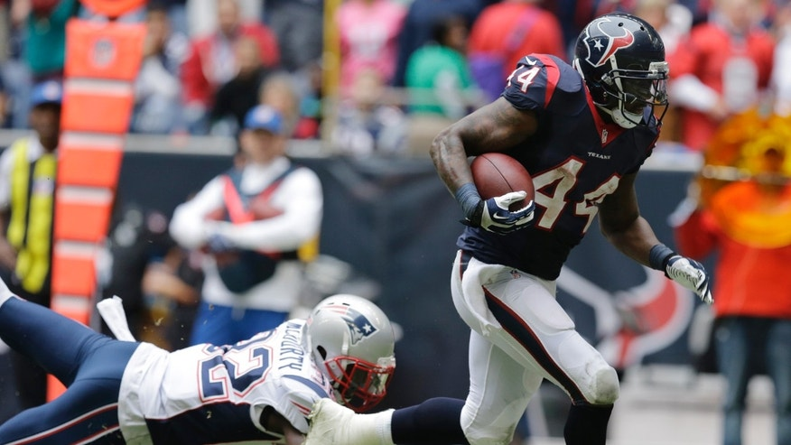 Houston Texans' Ben Tate (44) runs for a touchdown past New England Patriots' Devin McCourty (32) during the second quarter of an NFL football game on Sunday, Dec. 1, 2013, in Houston. (AP Photo/Patric Schneider)