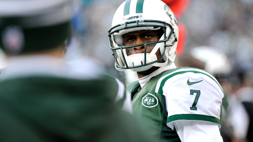 New York Jets quarterback Geno Smith looks on after being pulled  during the second half of an NFL football game against the Miami Dolphins, Sunday, Dec. 1, 2013, in East Rutherford, N.J. (AP Photo/Bill Kostroun)