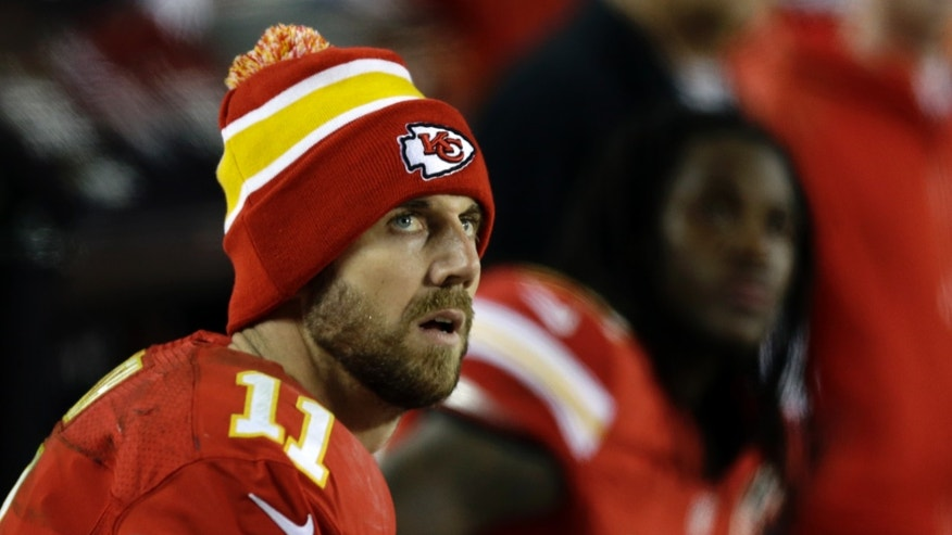 Kansas City Chiefs quarterback Alex Smith (11) looks at the scoreboard during the second half of an NFL football game against the Denver Broncos, Sunday, Dec. 1, 2013, in Kansas City, Mo. The Broncos won 35-28. (AP Photo/Charlie Riedel)
