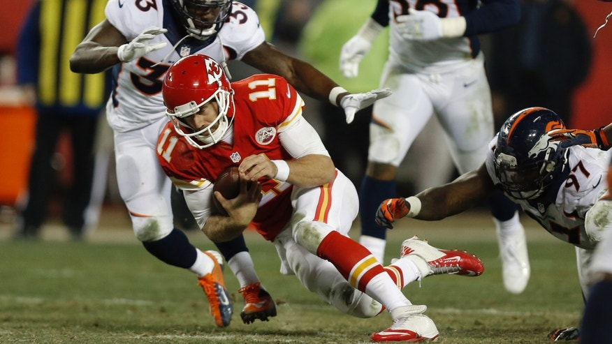 Kansas City Chiefs quarterback Alex Smith (11) slides to ground as Denver Broncos strong safety Duke Ihenacho (33) and defensive end Malik Jackson (97) chase him during the second half of an NFL football game, Sunday, Dec. 1, 2013, in Kansas City, Mo. (AP Photo/Ed Zurga)