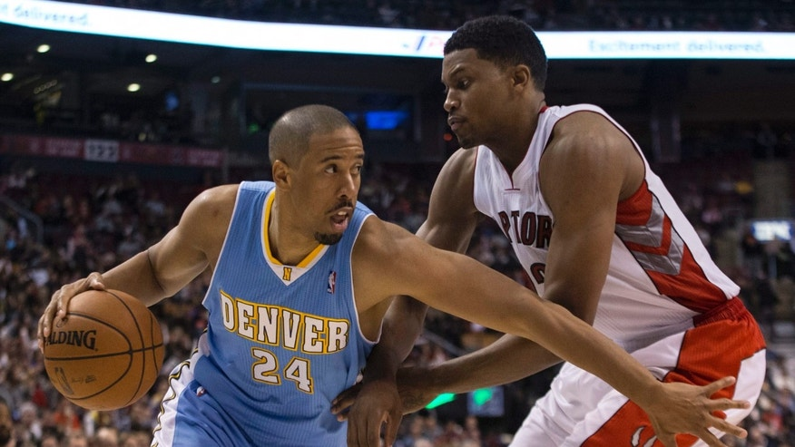 Denver Nuggets' Andre Miller drives past Toronto Raptors' Rudy Gay during the first half of an NBA basketball game on Sunday, Dec. 1, 2013, in Toronto. (AP Photo/The Canadian Press, Chris Young)