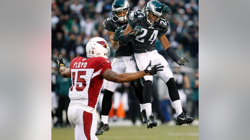 Philadelphia Eagles Bradley Fletcher celebrates with teammate Patrick Chung, right, after Fletcher knocked the ball away from Arizona Cardinals Michael Floyd during an NFL football game on Sunday, Dec. 1, 2013, in Philadelphia.  (AP Photo/The Philadelphia Inquirer, Ron Cortes) PHIX OUT; TV OUT; MAGS OUT; NEWARK OUT