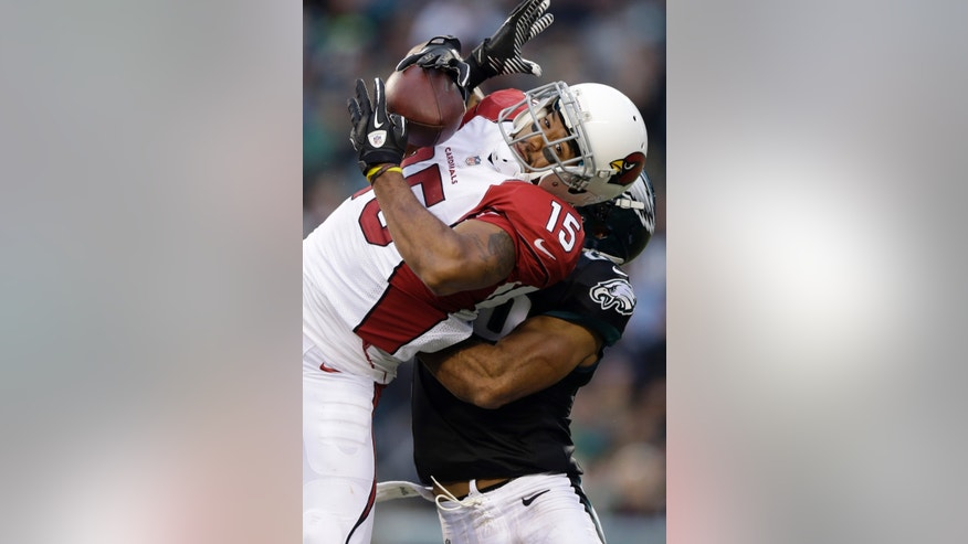 Arizona Cardinals' Michael Floyd pulls in a pass against Philadelphia Eagles' Nate Allen during the second half of an NFL football game, Sunday, Dec. 1, 2013, in Philadelphia. (AP Photo/Matt Rourke)