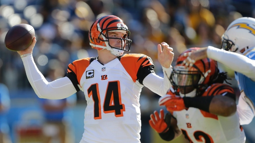 Cincinnati Bengals quarterback Andy Dalton (14) throws a pass while playing against the San Diego Chargers during the first half in an NFL football game on Sunday, Dec. 1, 2013, in San Diego. (AP Photo/Lenny Ignelzi)