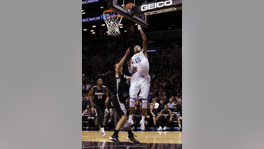 Kentucky's Willie Cauley-Stein (15) shoots over Providence's Carson Desrosiers (33) during the first half of an NCAA college basketball game Sunday, Dec. 1, 2013, in New York. (AP Photo/Frank Franklin II)