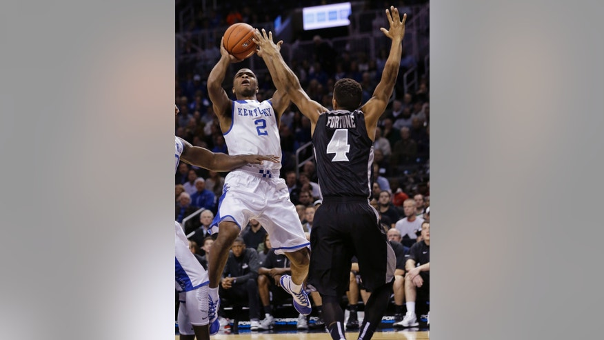 Kentucky's Aaron Harrison (2) shoots over Josh Fortune (4) during the first half of an NCAA college basketball game Sunday, Dec. 1, 2013, in New York. (AP Photo/Frank Franklin II)