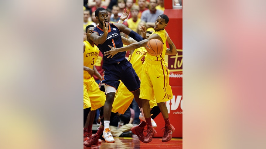 Auburn guard KT Harrell, left, passes in front of Iowa State guard Monte Morris, right, during the second half of an NCAA college basketball game Monday, Dec. 2, 2013, in Ames, Iowa. Iowa State won 99-70. (AP Photo/Charlie Neibergall)