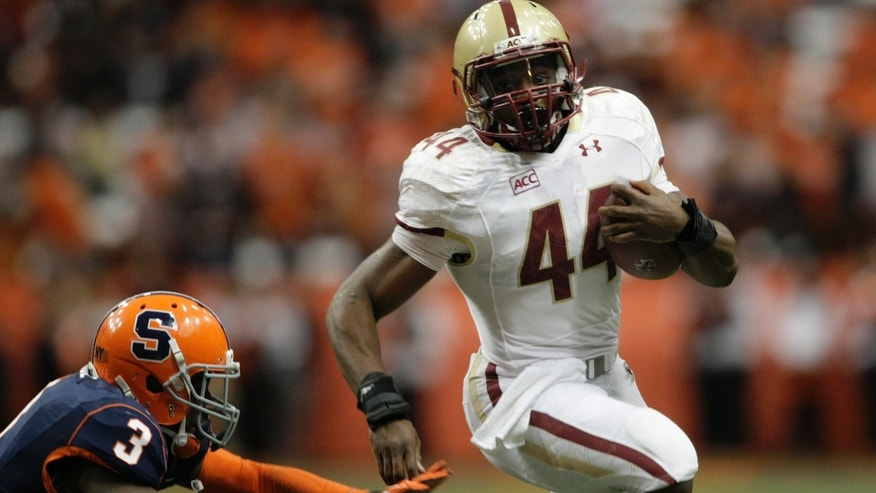 Boston College's Andre Williams, right, runs past Syracuse's Durell Eskridge for a touchdown in the first quarter of an NCAA college football game in Syracuse, N.Y., Saturday, Nov. 30, 2013. (AP Photo/Nick Lisi)