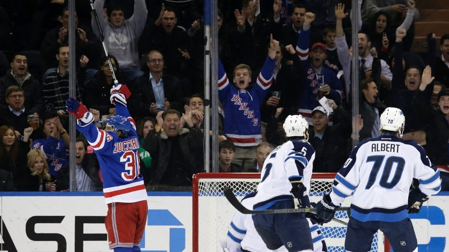 New York Rangers right wing Mats Zuccarello (36) of Norway celebrates after scoring a goal on Winnipeg Jets goalie Ondrej Pavelec of the Czech Republic in the first period of an NHL hockey game at Madison Square Garden in New York, Monday, Dec. 2, 2013. (AP Photo/Kathy Willens)