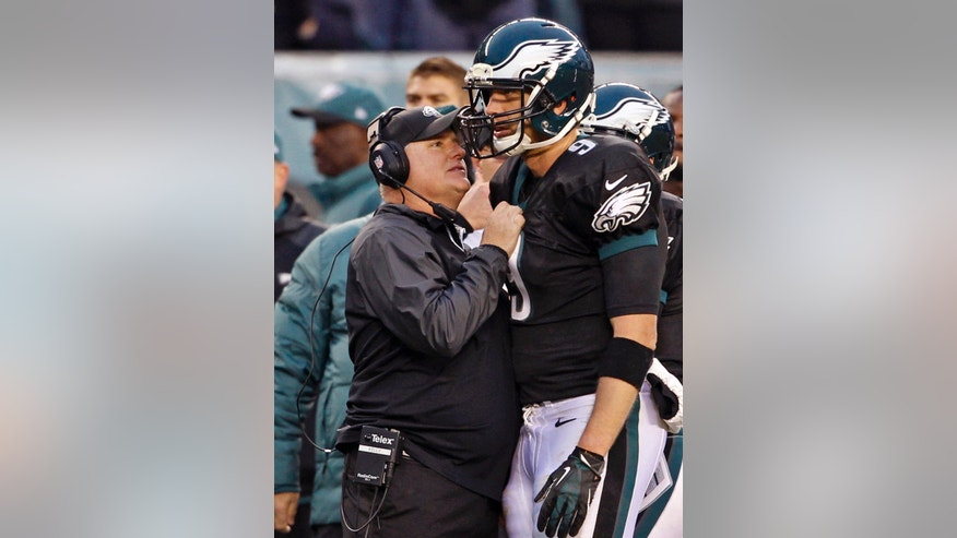 Philadelphia Eagles head coach Chip Kelly talks to Nick Foles during the second half of an NFL football game against the Arizona Cardinals on Sunday, Dec. 1, 2013, in Philadelphia.  (AP Photo/The Philadelphia Inquirer, Ron Cortes) PHIX OUT; TV OUT; MAGS OUT; NEWARK OUT