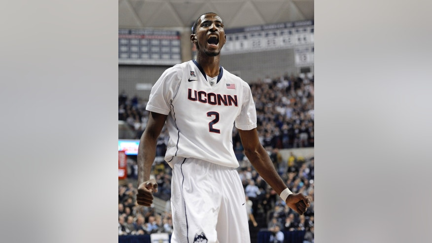 Connecticut's DeAndre Daniels reacts during the first half of an NCAA college basketball game against Florida, Monday, Dec. 2, 2013, in Storrs, Conn. (AP Photo/Jessica Hill)