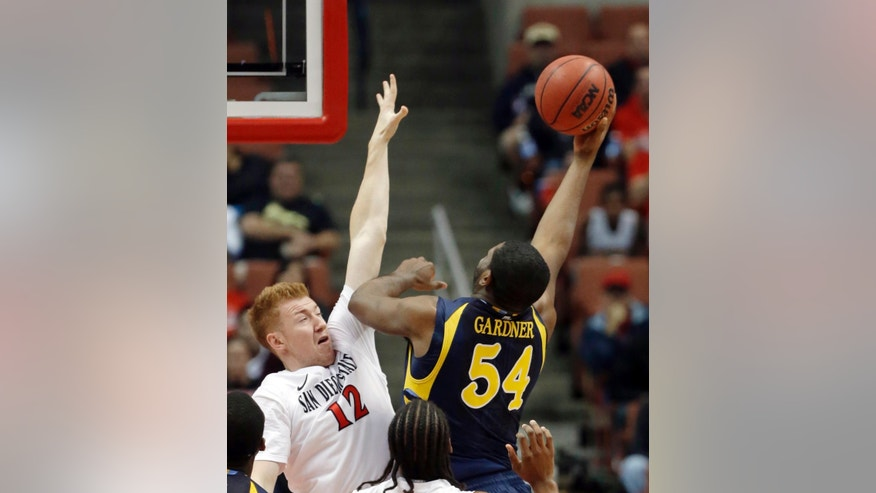 Marquette forward Davante Gardner (54) shoots as San Diego State forward James Johnson (12) defends in the first half of an NCAA college basketball game at the Wooden Legacy tournament in Anaheim, Calif., Sunday, Dec. 1, 2013.  (AP Photo/Reed Saxon)