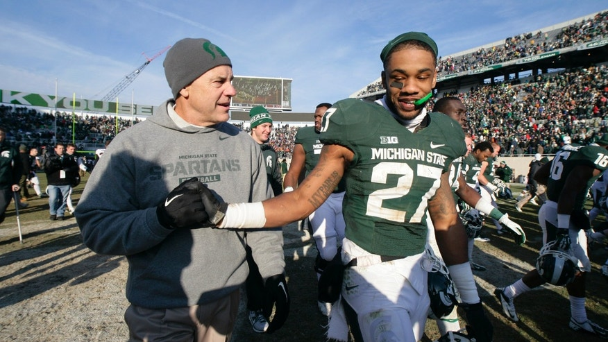 Michigan State coach Mark Dantonio, left, congratulates Kurtis Drummond (27) following a 14-3 win over Minnesota in an NCAA college football game, Saturday, Nov. 30, 2013, in East Lansing, Mich. (AP Photo/Al Goldis)