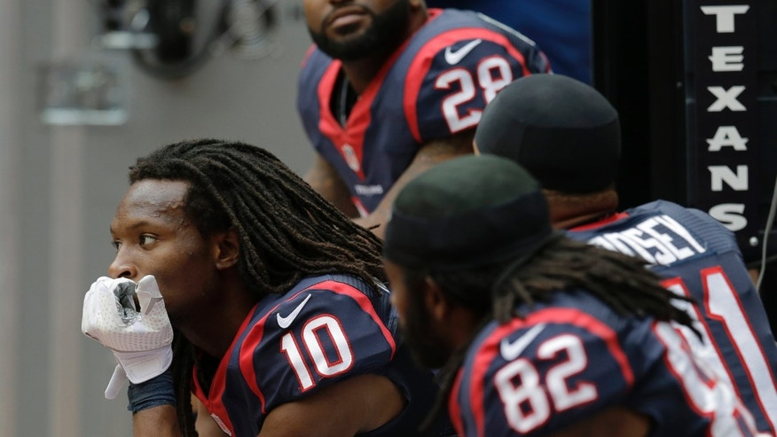Houston Texans' DeAndre Hopkins (10) sits on the bench during the fourth quarter of an NFL football game against the New England Patriots on Sunday, Dec. 1, 2013, in Houston. (AP Photo/Patric Schneider)