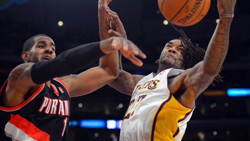 Portland Trail Blazers forward Dorell Wright, left, and Los Angeles Lakers center Jordan Hill battle for a rebound during the first half of an NBA basketball game Sunday, Dec. 1, 2013, in Los Angeles. (AP Photo/Mark J. Terrill)