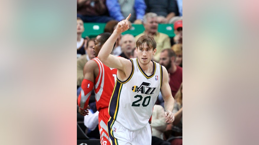 Utah Jazz's Gordon Hayward (20) runs up the court after scoring against the Houston Rockets in the first quarter of an NBA basketball game Monday, Dec. 2, 2013, in Salt Lake City. (AP Photo/Rick Bowmer)