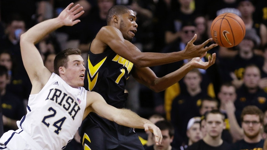 Notre Dame forward Pat Connaughton (24) fights for a rebound with Iowa forward Melsahn Basabe during the first half of an NCAA college basketball game, Tuesday, Dec. 3, 2013, in Iowa City, Iowa. (AP Photo/Charlie Neibergall)