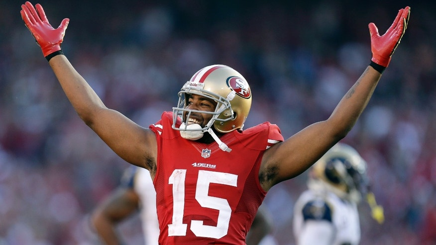 San Francisco 49ers wide receiver Michael Crabtree celebrates after a 60-yard reception against the St. Louis Rams during the third quarter of an NFL football game in San Francisco, Sunday, Dec. 1, 2013. (AP Photo/Tony Avelar)