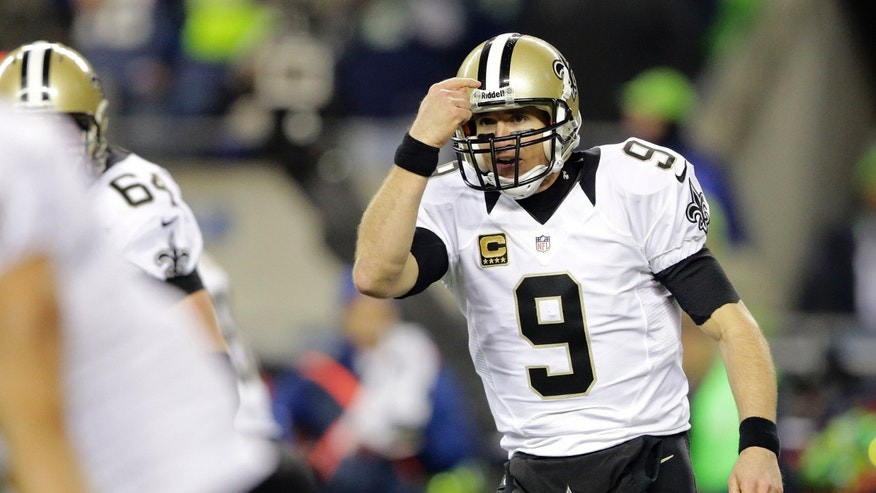 New Orleans Saints quarterback Drew Brees gestures in the second half of an NFL football game against the Seattle Seahawks, Monday, Dec. 2, 2013, in Seattle. (AP Photo/Scott Eklund)