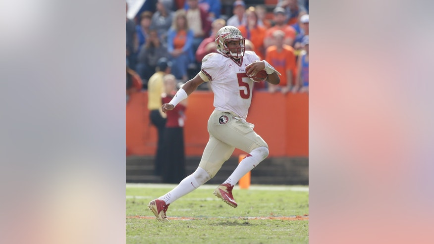 Florida State quarterback Jameis Winston scrambles for yardage against Florida during the second half of an NCAA college football game in Gainesville, Fla., Saturday, Nov. 30, 2013. Florida State defeated Florida 37-7.(AP Photo/John Raoux)