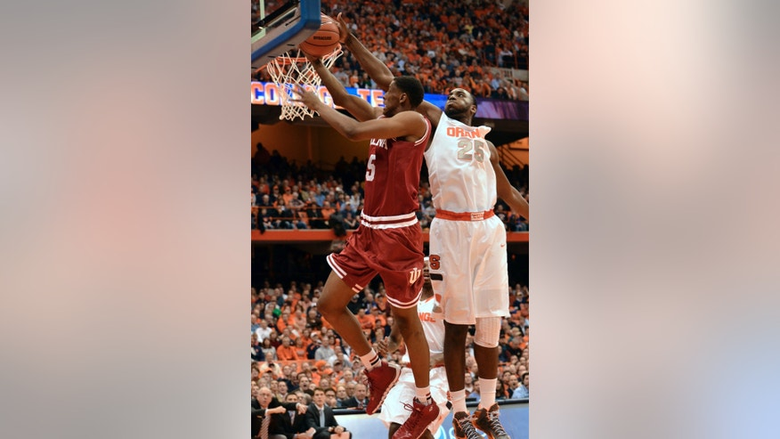 Syracuse's Rakeem Christmas, right, rejects the shot of Indiana'sTroy Williams during the first half of an NCAA college basketball game in Syracuse, N.Y., Tuesday, Dec. 3, 2013. (AP Photo/Kevin Rivoli)