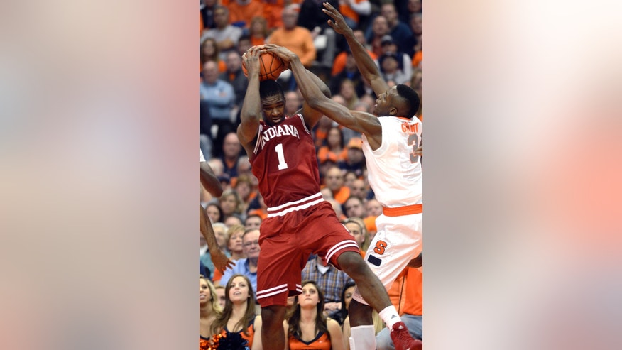 Indiana's Noah Vonleh(1) grabs a rebound against Syracuse's Jeremi Grant during the first half of an NCAA college basketball game in Syracuse, N.Y., Tuesday, Dec. 3, 2013. (AP Photo/Kevin Rivoli)