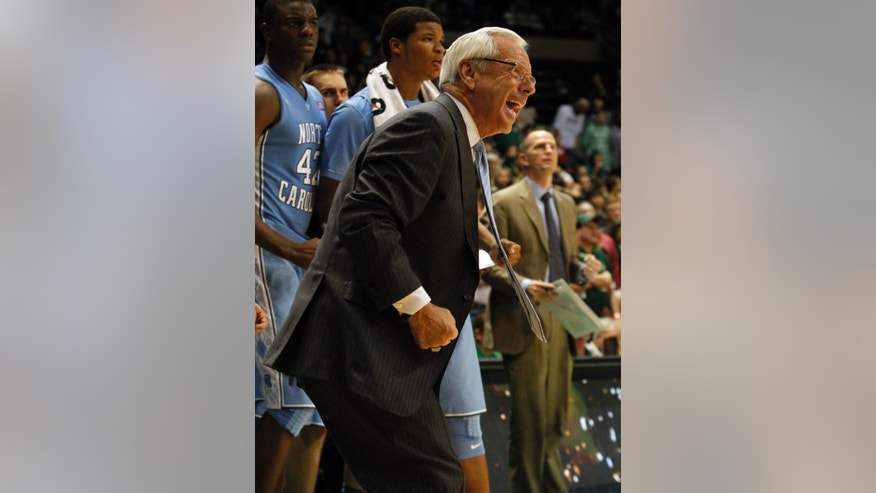 North Carolina head coach Roy Williams reacts to a call during the second half of an NCAA college basketball game against UAB on Sunday, Dec. 1, 2013, in Birmingham, Ala. (AP Photo/Butch Dill)