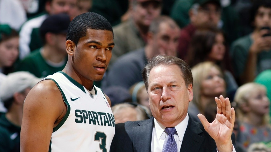 Michigan State coach Tom Izzo, right, talks to Alvin Ellis III (3) during the second half of an NCAA college basketball game against Mount St. Mary's, Friday, Nov. 29, 2013, in East Lansing, Mich. Michigan State won 98-65. (AP Photo/Al Goldis)