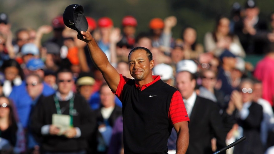 "FILE - In this Dec. 4, 2011 file photo, Tiger Woods waves his cap after winning the Chevron World Challenge golf tournament at Sherwood Country Club in Thousand Oaks, Calif. Woods never won what he often referred to as his ""hometown event"" at Riviera. He made up for it by winning five times at Sherwood Country Club. (AP Photo/Danny Moloshok, File)"