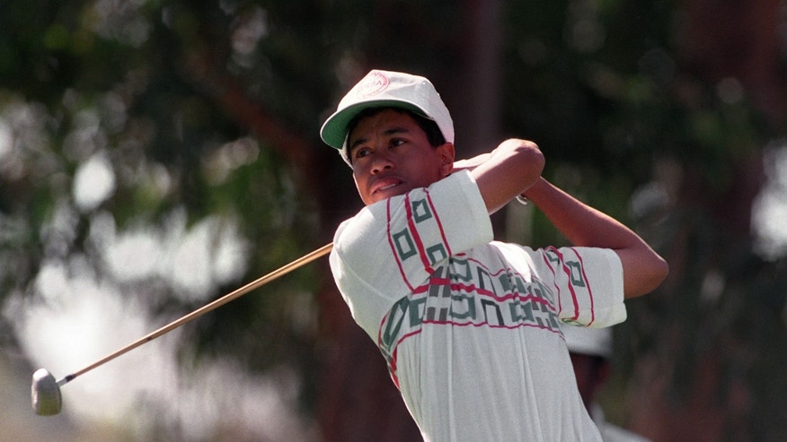 FILE - In this Feb. 26, 1992 file photo, amateur Tiger Woods tees off at the 11th hole during the Pro-Am for the Los Angeles Open at Riviera Country Club in Los Angeles.  Woods made his PGA Tour debut at Riviera when he was a 16-year-old junior in high school.  (AP Photo/Bob Galbraith, File)