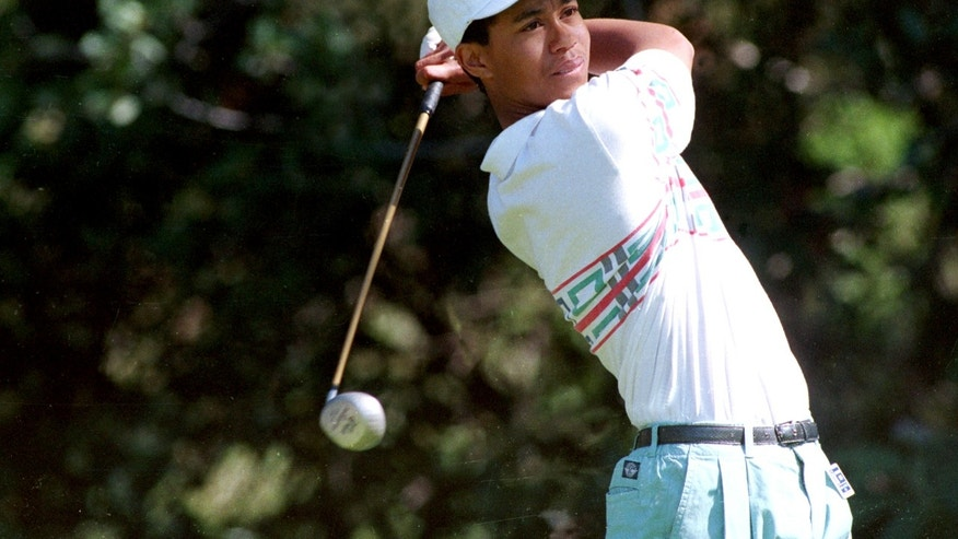 FILE - In this Feb. 26, 1992 file photo, amateur golfer Tiger Woods tees off at the 12th hole during the Pro-Am for the Los Angeles Open at Riviera Country Club in Los Angeles. Woods made his PGA Tour debut at Riviera when he was a 16-year-old junior in high school.  (AP Photo/Bob Galbraith, File)