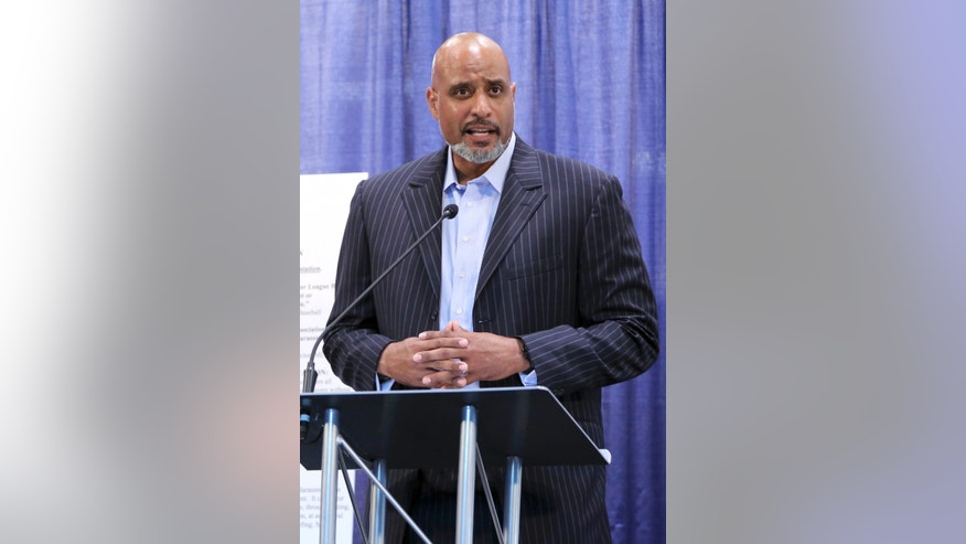 FILE - In this July 16, 2013 file photo, Major League Baseball Players Association Director of Player Services Tony Clark speaks to reporters during a news conference in New York. Clark is expected to be approved as executive director of the baseball players' union following the death of Michael Weiner. (AP Photo/Mary Altaffer, File)