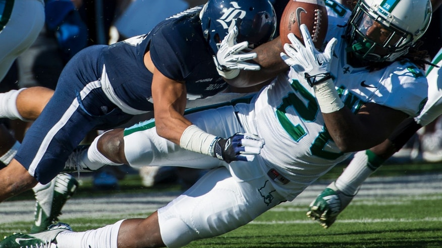 Tulane running back Rob Kelley (28) fumbles as he is hit by Rice cornerback Bryce Callahan (29) during the first quarter of an NCAA college football game at Rice Stadium, Saturday, Nov. 30, 2013, in Houston. Rice recovered the fumble. (AP Photo/Houston Chronicle, Smiley N. Pool) MANDATORY CREDIT