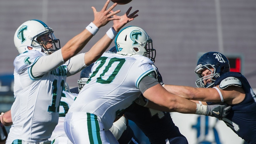 Tulane quarterback Nick Montana (11) reaches for a high snap during the first quarter  during the first quarter of an NCAA college football game against Rice at Rice Stadium, Saturday, Nov. 30, 2013, in Houston. (AP Photo/Houston Chronicle, Smiley N. Pool) MANDATORY CREDIT