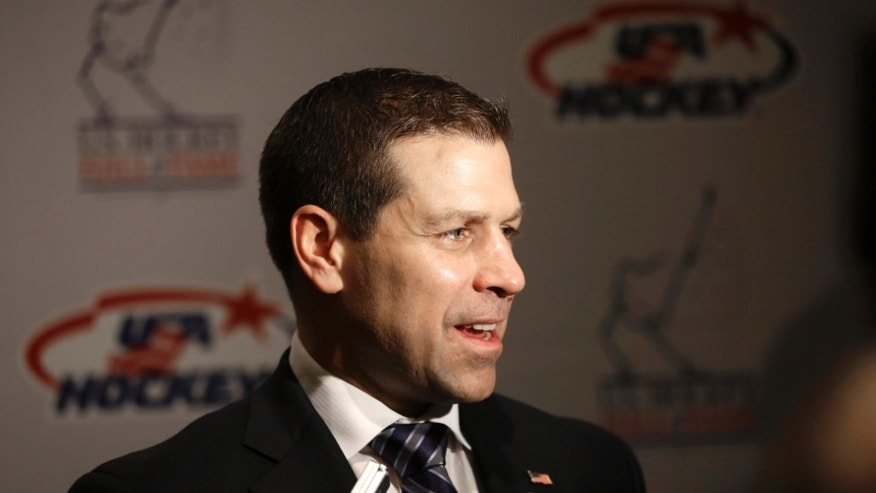 Doug Weight addresses the media before his induction into the United States Hockey Hall of Fame in Detroit, Monday, Dec. 2, 2013. Weight is an assistant coach for the New York Islanders. (AP Photo/Carlos Osorio)