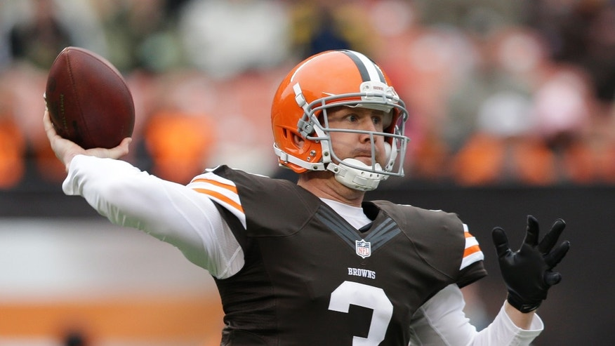 Cleveland Browns quarterback Brandon Weeden passes to wide receiver Josh Gordon for a first down against the Jacksonville Jaguars in the first quarter of an NFL football game on Sunday, Dec. 1, 2013, in Cleveland. (AP Photo/Tony Dejak)