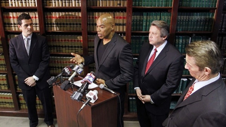 December 3, 2013: Former Kansas City Chiefs linebacker Chris Martin, second from left, talks about his football injures as he and his attorney Ken McClain, second from right, talk about a lawsuit filed today against the Kansas City Chiefs organization during a news conference in Independence, Mo. (AP Photo)