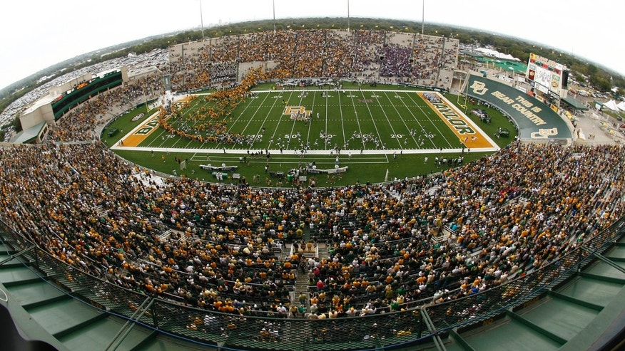 FILE - In this Oct. 23, 2010 file photo, Baylor and Kansas State fans fill Floyd Casey stadium after heavy rain and lighting forced a delay of their NCAA football game, in Waco, Texas. Baylor plays its final game at Floyd Casey Stadium Saturday, Dec. 7, 2013, after 64 seasons.(AP Photo/Waco Tribune Herald, Jose Yau, File)