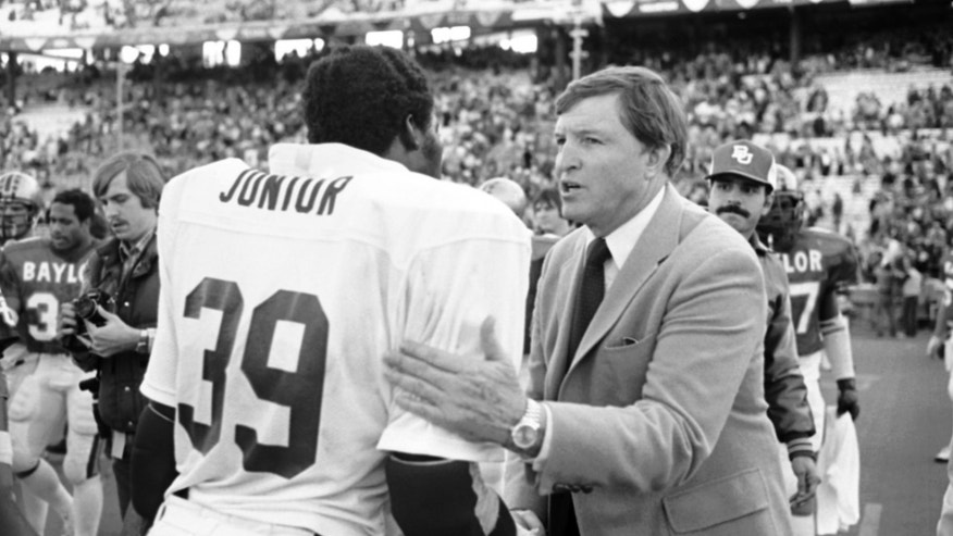 FILE - In this Jan. 1, 1981, file photo, Baylor head football coach Grant Teaff, right, congratulates Alabama defensive end E.J. Junior after Alabama's 30-2 victory over his team in the Cotton Bowl college football game in Dallas. Two decades after his last game, Teaff is feeling emotional about Floyd Casey Stadium which the No. 9 Bears will close Saturday, Dec. 7, 2013, after 64 seasons, in a finale against No. 23 Texas when they can clinch at least a share of their first Big 12 title. (AP Photo/Bill Haber, File)